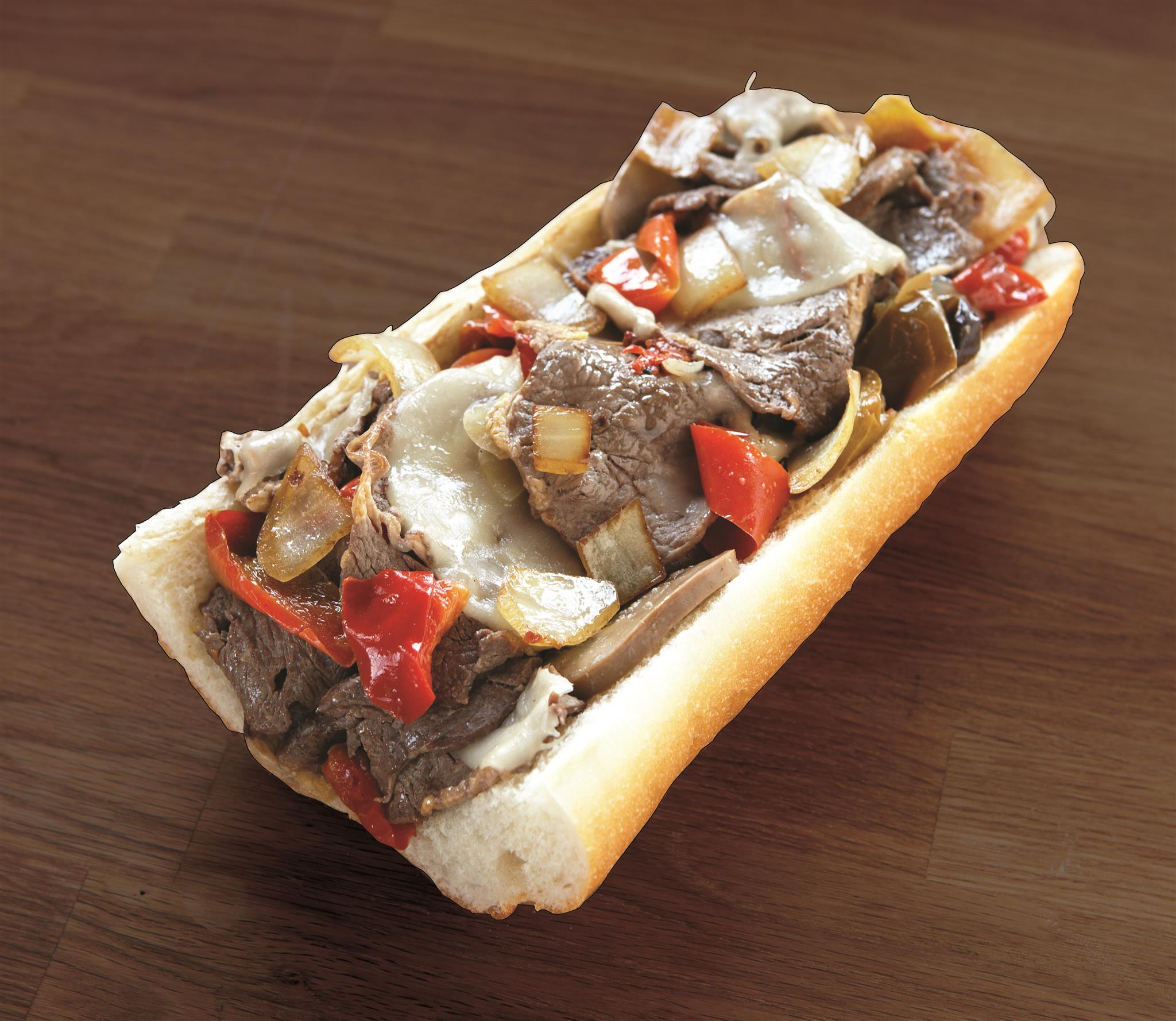 Philly cheesesteak with onions peppers and mushrooms